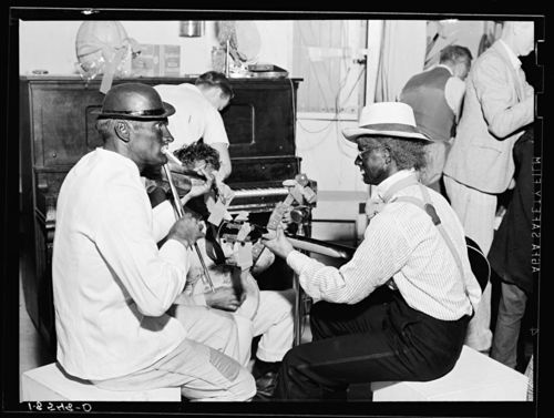 Dorothea Lange Camp talent provides music for dancing at Shafter camp for migrants. Halloween party, Shafter, California 1938