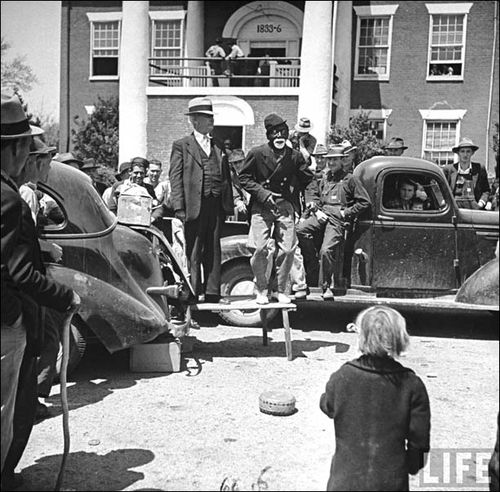 Med 07 Bernard Hoffman Life Traveling medicine staging a minstrel show outside the Lumpkin County Courthouse. 1942