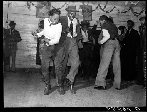 Marion Post Wolcott Jitterbugging in Negro juke joint, Saturday evening, outside Clarksdale, Mississippi