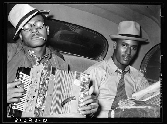 Russell Lee Negro musicians playing accordion and washboard in automobile. Near New Iberia, Louisiana