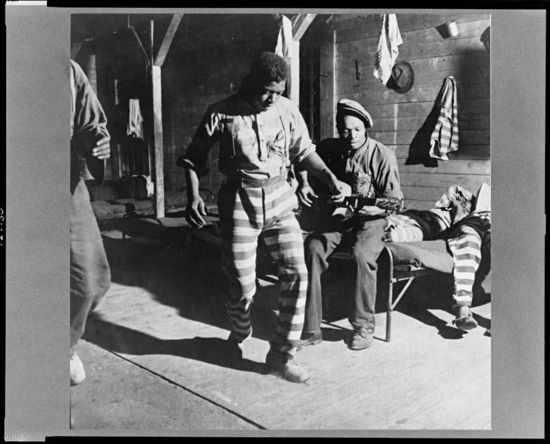 Jack Delano 1941 A prisoner dancing while another plays the guitar at a prison camp. Greene County, Georgia.