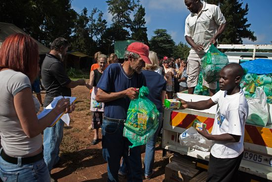 Finbarr O'Reilly Reuters A man receives a monthly supply of food aid donated to residents of a squatter camp for poor white South Africans at Coronation Park in Krugersdorp on March 6 2010