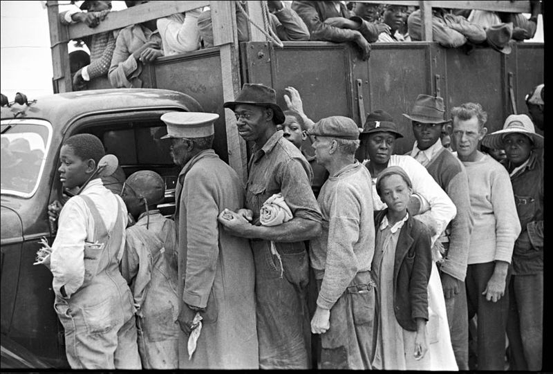 Marion Post Wolcott Vegetable workers migrants waiting after work to be paid Near Homestead Florida 1939 02