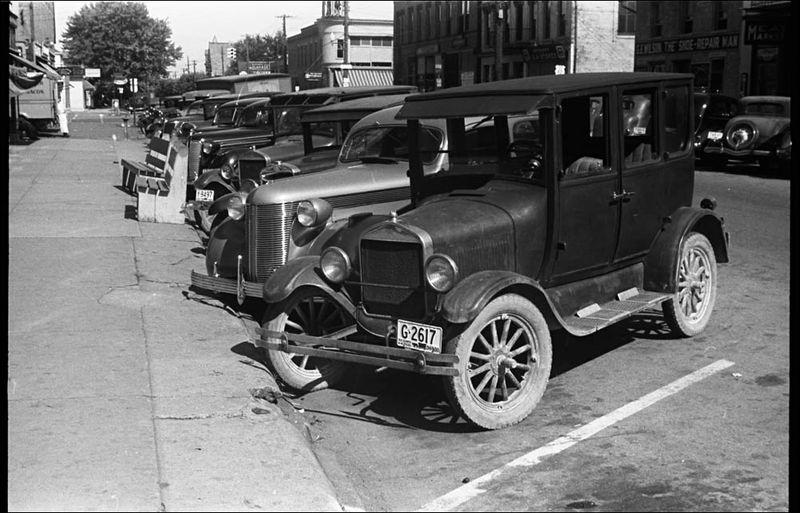 Ben Shahn Cars line streets of Plain City Ohio 1938