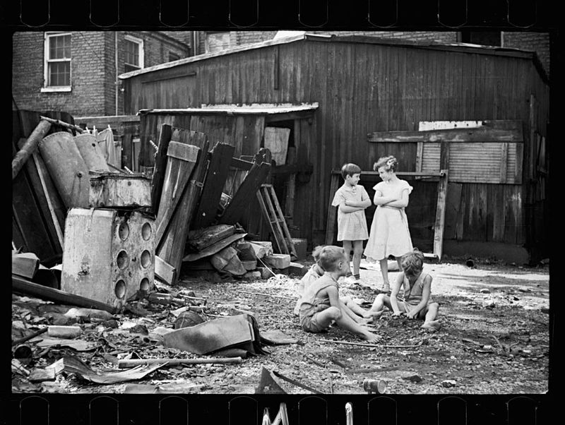 Carl Mydans Slum children at play Washington DC Children in their backyard near the Capitol This area inhabited by both black and white 1935