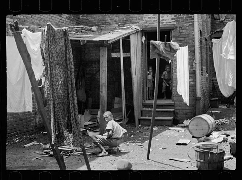 Carl Mydans Negro backyard near Capitol Washington DC Negro children have just discovered the cameraman and are concerned at his presence 1935