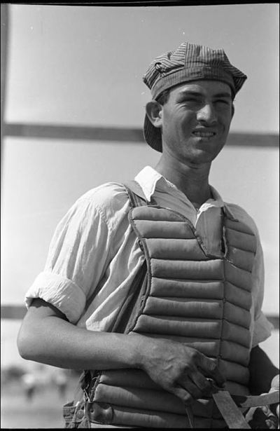 Russell Lee Migratory laborers like to play baseball Here is one of them in a catchers uniform at the Agua Fria Migratory Labor Camp Arizona 1940