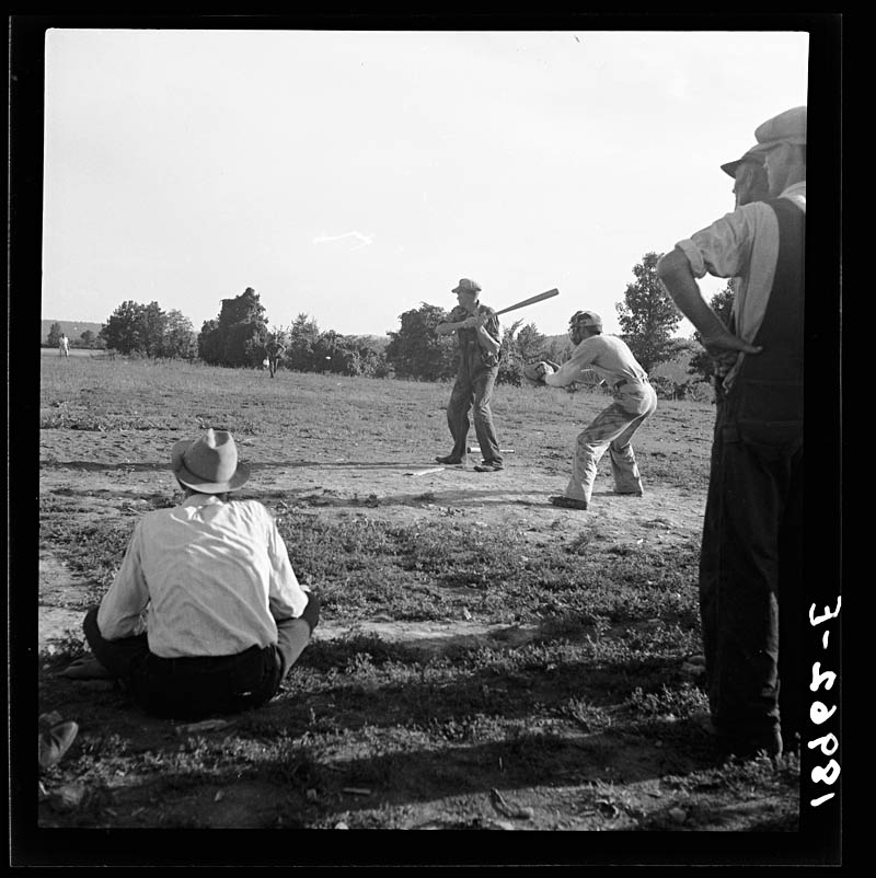 Dorothea Lange Near mountain home northern Arkansas on US 62 Farmers baseball game in the country From this area many have gone to California to work in agriculture 1938