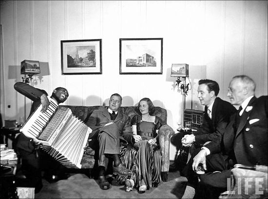 Margaret Bourke White African Amer accordianist playing at post Thanksgiving party at the home of Will Moor well to do polio patient Warm Spring GA Nov 1938