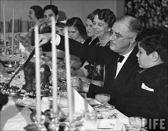 Margaret Bourke White Pre. Franklin D. Roosevelt w his wife Eleanor serving Thanksgiving turkey to polio patients Warm Springs Nov 1938