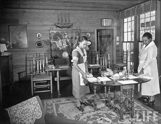 Margaret Bourke White A maid & cook set the table for breakfast in the living room of the Little White House one of the Pres Franklin D Roosevelts vacation residences Warm Springs GA Nov 1938