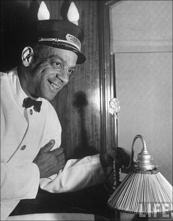 Margaret Bourke White Portrait of Pullman porter Harry Lucas working in Pres Franklin D Roosevelts private car on his trip to Warm Springs November 1938