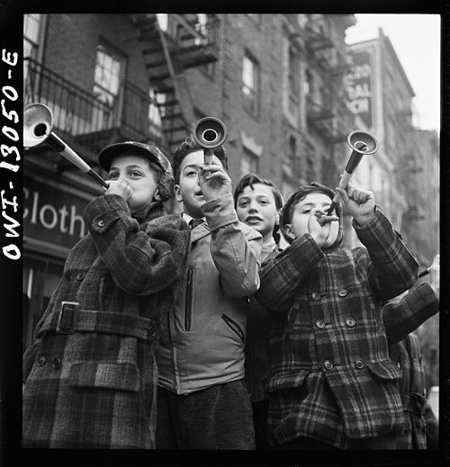 Marjory Collins New York New York Blowing horns on Bleeker Street on New Years Day 1943