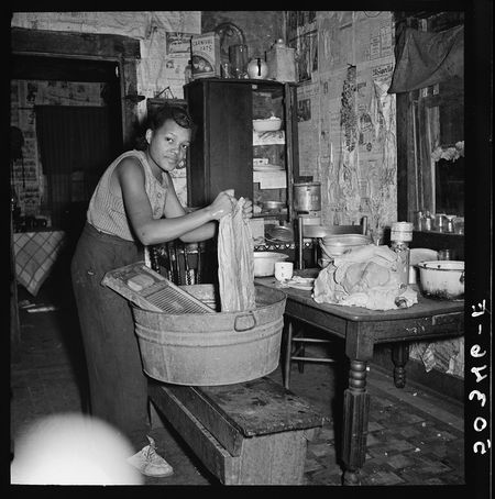 Marion Post Wolcott FSA Coal miners daughter doing the family wash All the water must be carried from up the hill. Bertha Hill West Virginia 1938-15